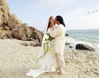 Newly Married Couple Kissing on Beach
