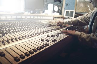 Man Mixing Music