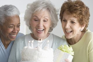 Elder Women with Birthday Cake