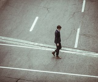 Young Businessman Crossing Street