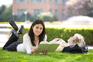 College Girl on Lawn with Book
