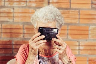 Older Woman Looking Through Camera