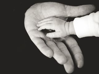 Baby hand in Parents' hand