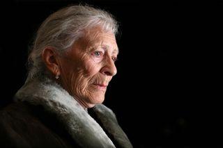 Elder Woman against Black Background
