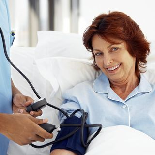 Woman in Hospital with Pressure Cuff