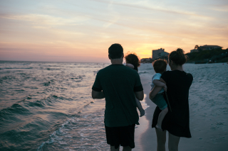 Family Walking on Beach