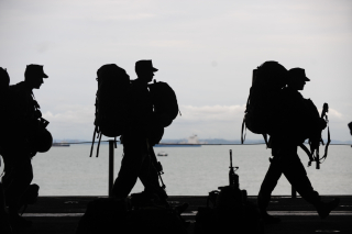 Military Men Walking with Gear