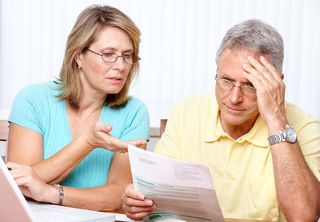 Elder Couple Reviewing Papers