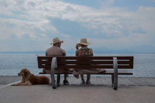 Elder Couple Sitting on Bench