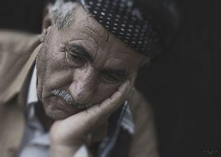 Older Man Resting Head on Hand