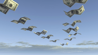 Dollars flying away12116264