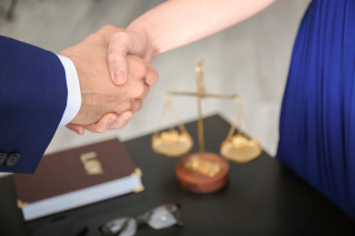 Trust concept Lawyer-shaking-hands-with-clie-230355358